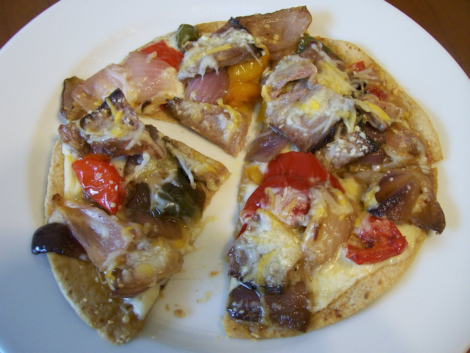 ... Steak, Roasted Peppers and Onions, a sprinkle of Colby-Jack Cheese and