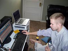 Adam mixing music at the Studio