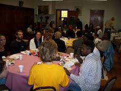 Faculty and Student share a meal