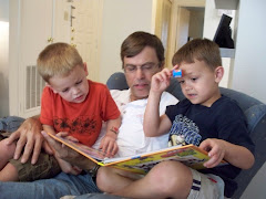 Grandad reading with Ethan and Aston on his birthday