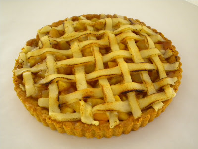 Apple almond tart--almond crust topped with glazed apples and a marzipan lattice