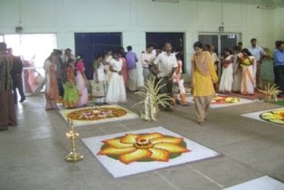 visitors enjoying athapoo; a scene from The Hindu, MetroPlus Athapoo Contest 2008