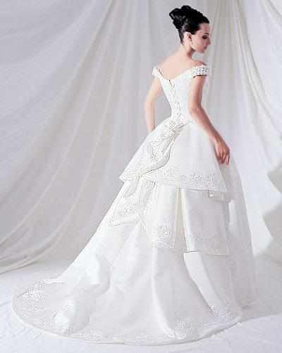 The bride is wearing a very beautiful white wedding dress which is designed