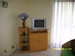Sala com TV e Sofá-cama