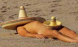 nude man sombrero at the beach