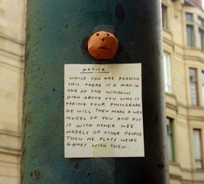 really funny notice on pole about person taking photos of people reading notice