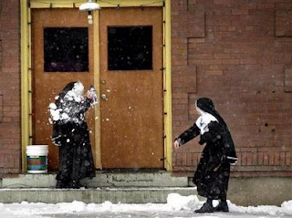 funny nuns snowball fighting