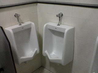 jokes photos stupid pic of two urinals too close together to be practical bad design