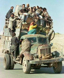 funny fridays photo of really overcrowded old truck with people looks like it could tip over
