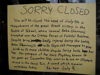 funny greek restaurant sign saying closed to celebrate the victory of tabouli photo