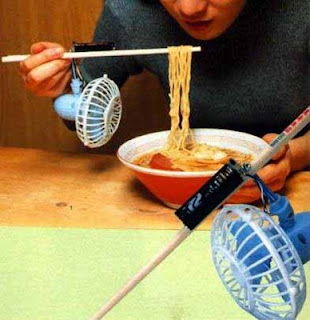 crazy photos funny inventions cool your noodles with a fan attached to chopsticks pic