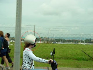 funny pic of woman on bike with helmet on wrong way around crazy