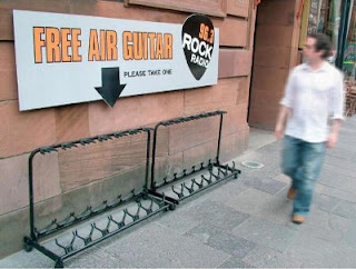 funny signs free air guitar photo really clever