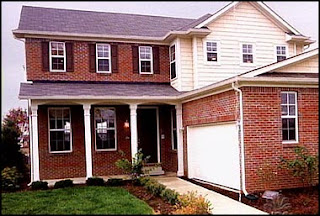 funny photo of house with a carport or garage without a driveway just a landscaped front yard
