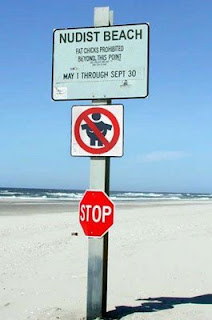 picture of funny nudist beach sign saying no fat chicks allowed past this point
