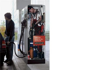 funny gas station photo man inside pumping gas