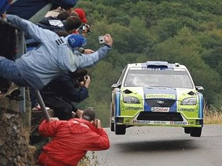 really funny car rally photo of people desperate to get a picture of car going past