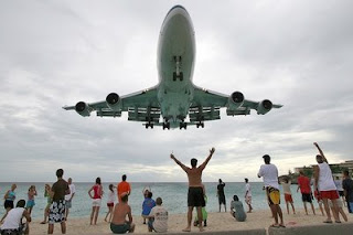 funny low flying 747 plane on the beach photo