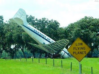 photo of funny plane signs caution watch out for low flying planes one crashed in background