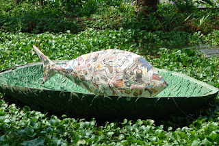 Paper mache fish in leaf-relief lily pad boat