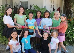 Children with beautiful rainstick they collaboratively made in Emily Frost and Gena Rabinowitz's Summer Environmental Art Camp, photo courtesy of Gena Rabinowitz
