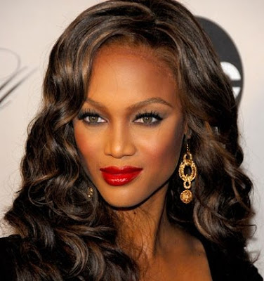 Tyra Banks with sophisticated multi-layered bun updos.