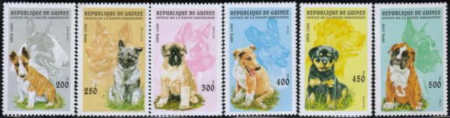 1996年ギニア共和国 ブル・テリア ノルウェジアン・エルクハウンド 秋田犬 スムース・コリー ロットワイラー ボクサーの子犬の切手