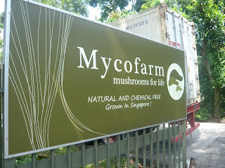 signboard with Mycofarm name at entrance to farm
