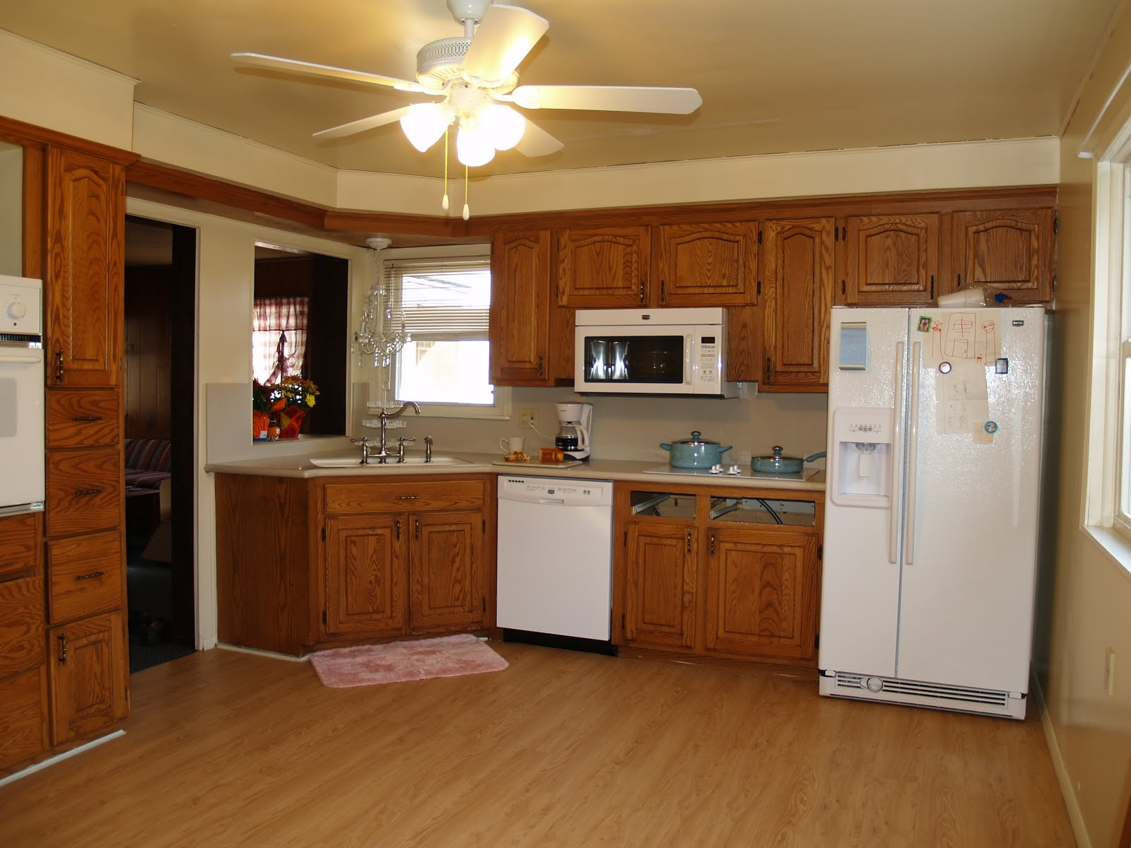 White Kitchen with Maple Cabinets and Appliances