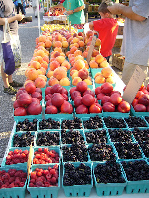 Rasberries, blackberries, peaches, local food at farmer's market