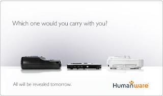 Nowy produkt firmy Humanware w towarzystwie dwóch innych urządzeń