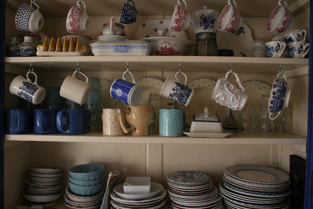 mugs and plates at the Underground Restaurant