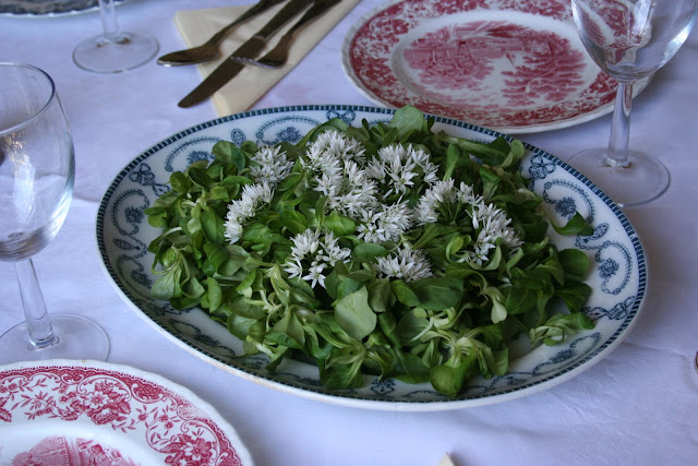 Wild garlic flower salad with walnut oil and dijon mustard dressing