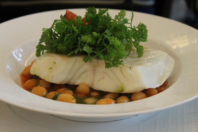 Half salted cod from Brittany, cooked in a broth, with Paimpol beans in basil, la regalade, paris