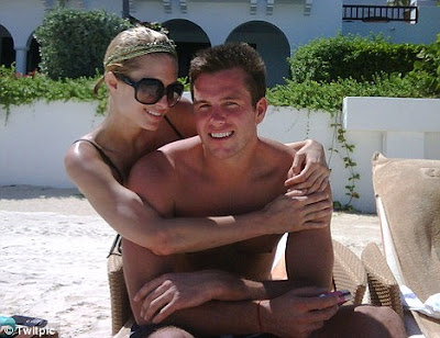 Paris Hilton Having Fun With Doug Reinhardt During Holiday
