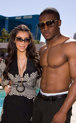 hot busty Kim Kardashian with boyfriend and NFL star Reggie Bush