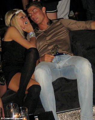 hot Paris Hilton cuddles up to Cristiano Ronaldo on a sofa in MyHouse in Hollywood