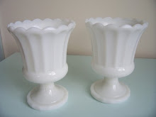 2 milk glass urns