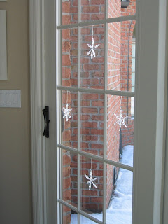 snowflakes in window for Christmas
