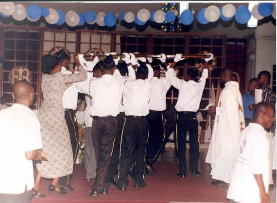 Cross being carried to Altar