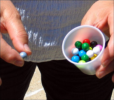 Cup of many colored Sixlets