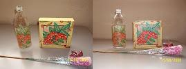 Decoupage em garrafa de suco e tela.