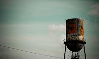 Photo of rusty water tower