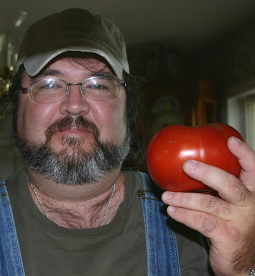 Jonathan Eller holding a tomato