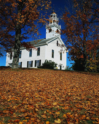 Old white frame church in autumn