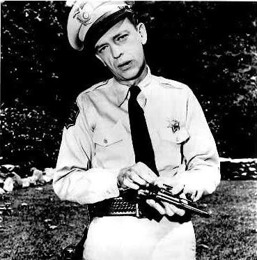 Barney Fife putting his bullet in his pistol