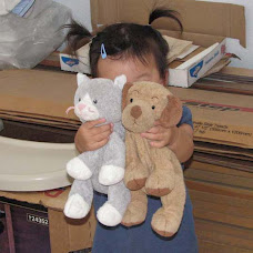 My Very Precious Granddaughter, K.C. with Kitty Kat and Nene (Sleep) Doggie