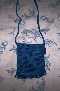 Mini cartera tejida