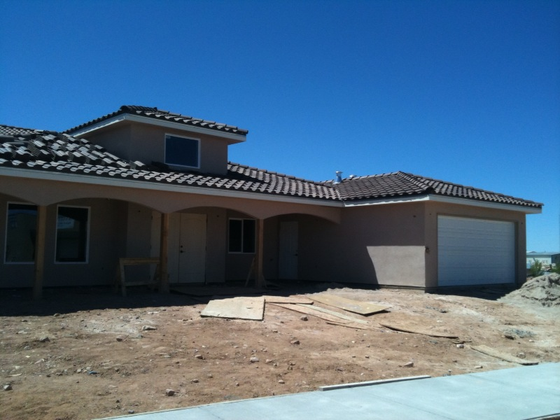 Bee hive homes of santa fe tile roof finished stucco for Hive homes
