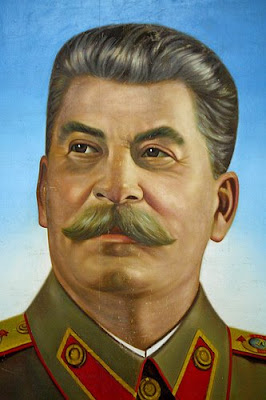 campaign poster next to propaganda posters of Lenin and Joseph StalinJoseph Stalin Propaganda Posters